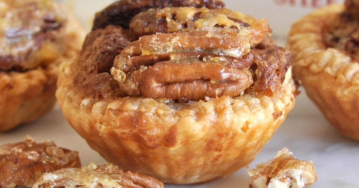 @cookwithmanuela's cover photo for 'Puff Pastry-Pecan Mini Tarts Topped with Caramelized Pecan Halves'