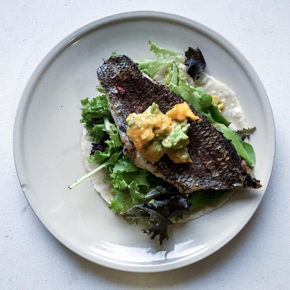 @approachingpaleo's cover photo for 'black sea bass taco with mango guacamole'
