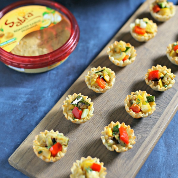 @cookinginstilettos's cover photo for 'Summer Entertaining with Garlicky Grilled Veggie MIni Tarts'