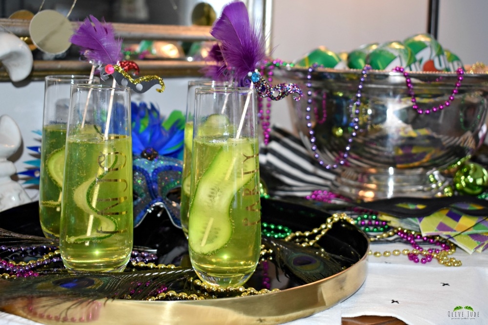 @olivejudeblog's cover photo for 'Cucumber Hurricane Twist: A Mardi Gras Cocktail | Olive Jude'