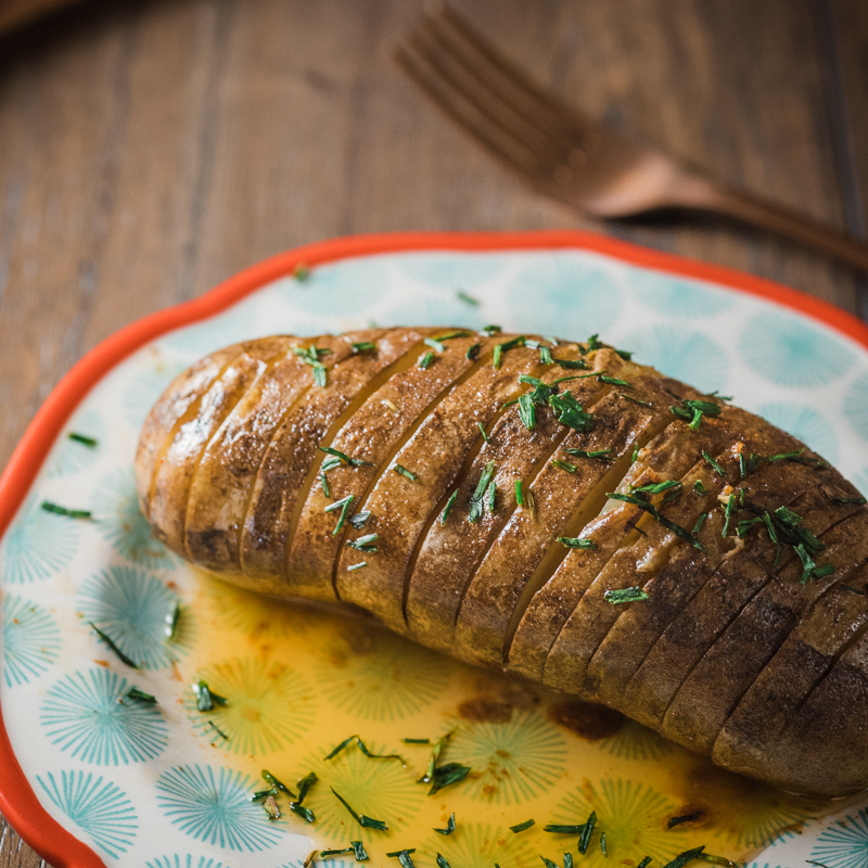 @deliciouseveryday's cover photo for 'Slow Cooker Hasselback Potatoes with Honey-Sriracha Butter'