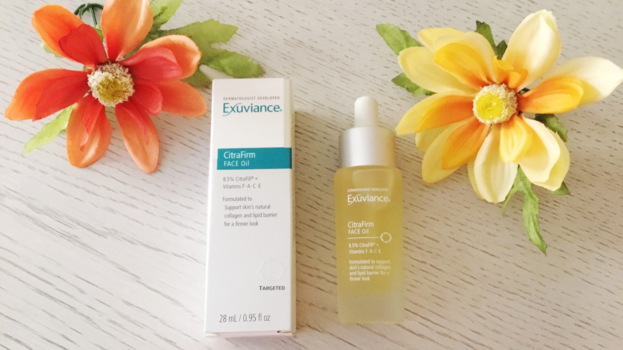 @susie_truett_'s cover photo for 'Exuviance CitraFirm Face Oil Review | 40andholding.com'