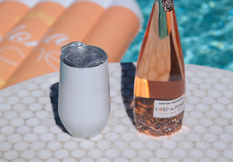 @palmspringsstyle's cover photo for 'Palm Springs Pool Essentials: Wine Tumbler and Float by Big Betty|Palm Springs Style'