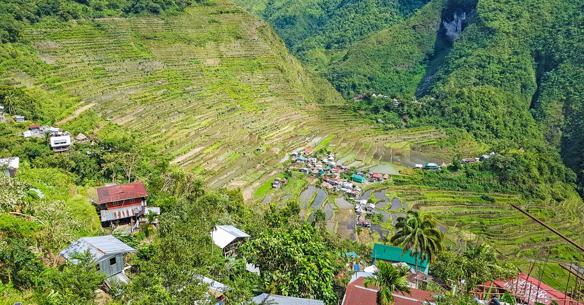 @guide2travel.ca's cover photo for 'Hiking Through Time on the Banaue Rice Terraces'