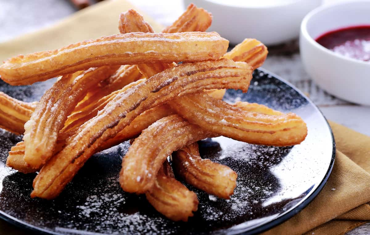@buddymantraa's cover photo for 'Easy Eggless Churros Recipe With Chocolate Sauce | Crunchy Yet Tender'