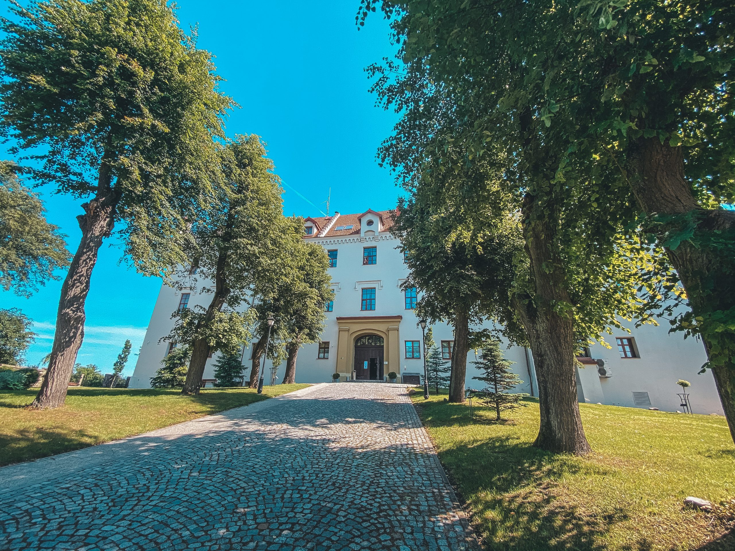 @milenacorleoneofficial's cover photo for '7 Reasons to visit Hotel Zamek Ryn (Castle) - Ship Me There'